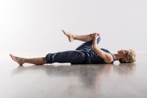 BodyViva-The-Best-Stretches-For-Your-Back-Knee-to-chest