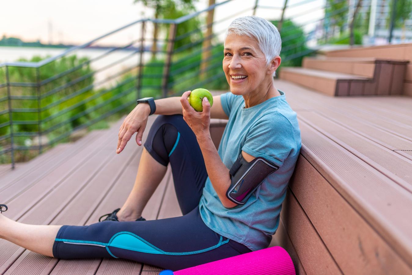 healthy mature aged women enjoying apple BodyViva
