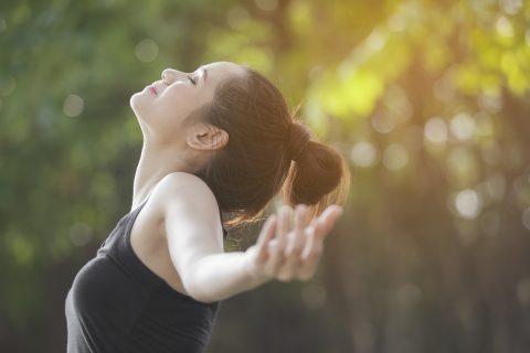 women performing outdoor yoga BodyViva