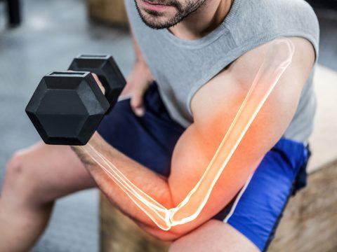 man lifting dumbbells resistance training healthy bones BodyViva