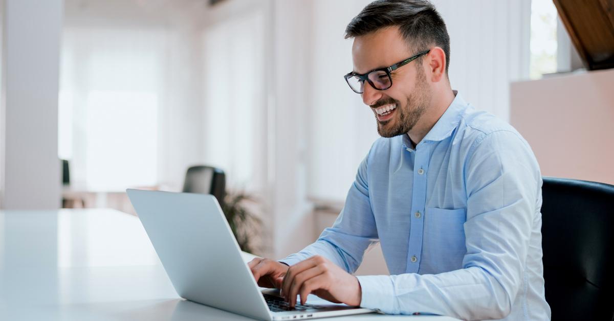 man typing at computer BodyViva massage benefits