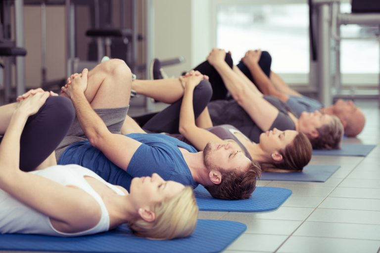 group class stretching at gym