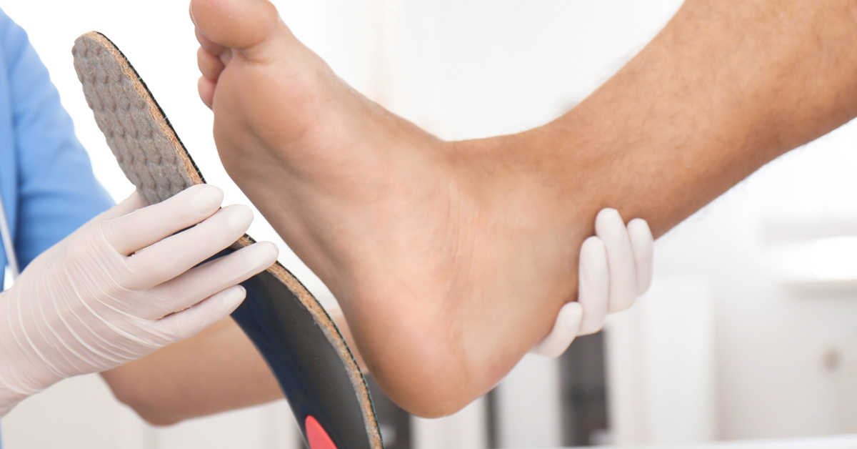 podiatrist testing shoe insoles for patient how a podiatrist can help you