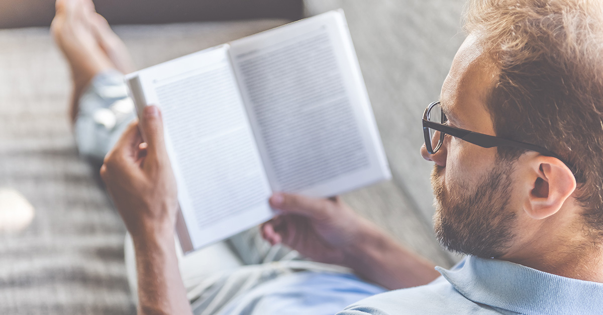 man reading novel How to Maintain a Positive Mindset when Coping with an Injury