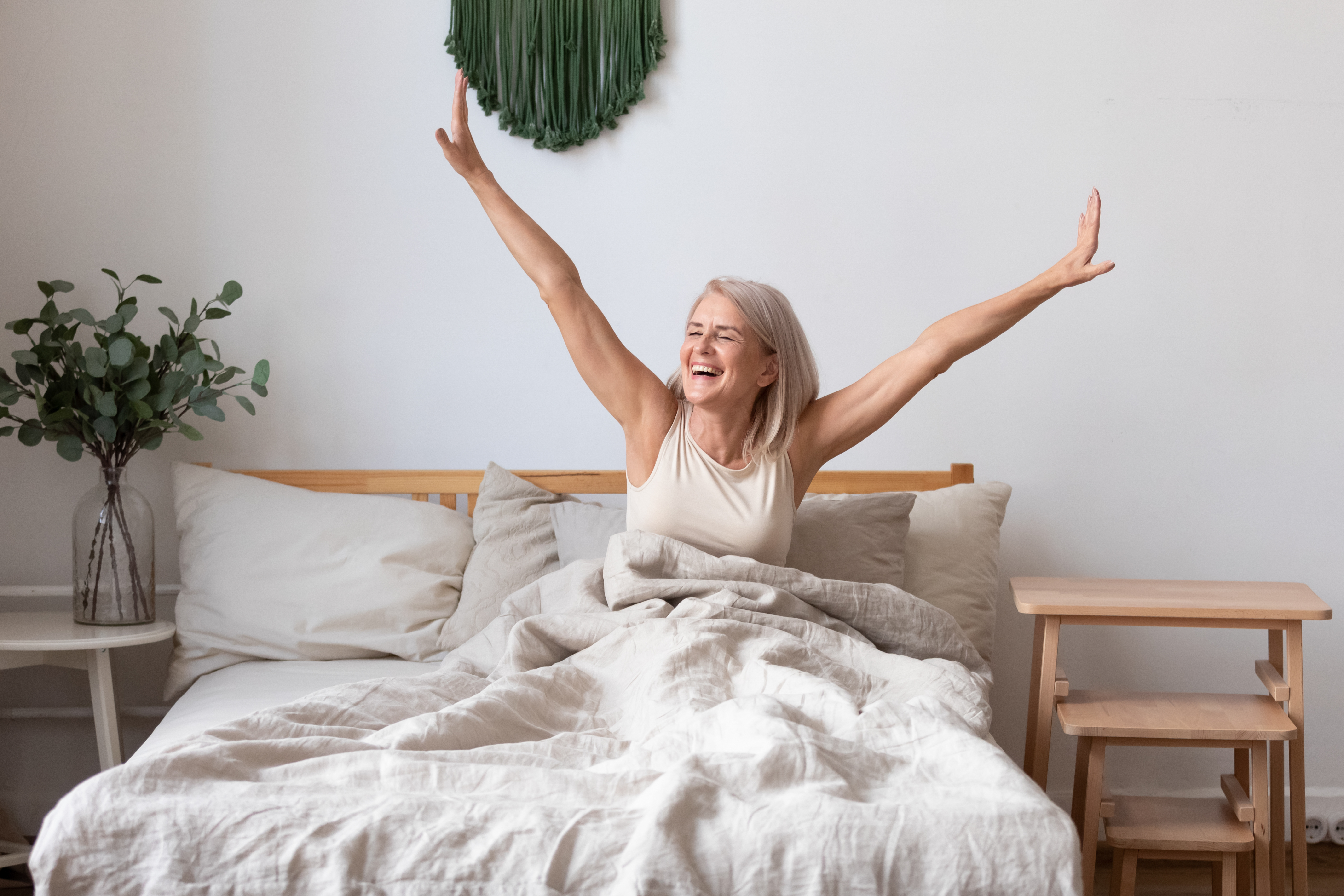 women stretching waking up BodyViva Ways To Speed Up Recovery Outside Of The Clinic