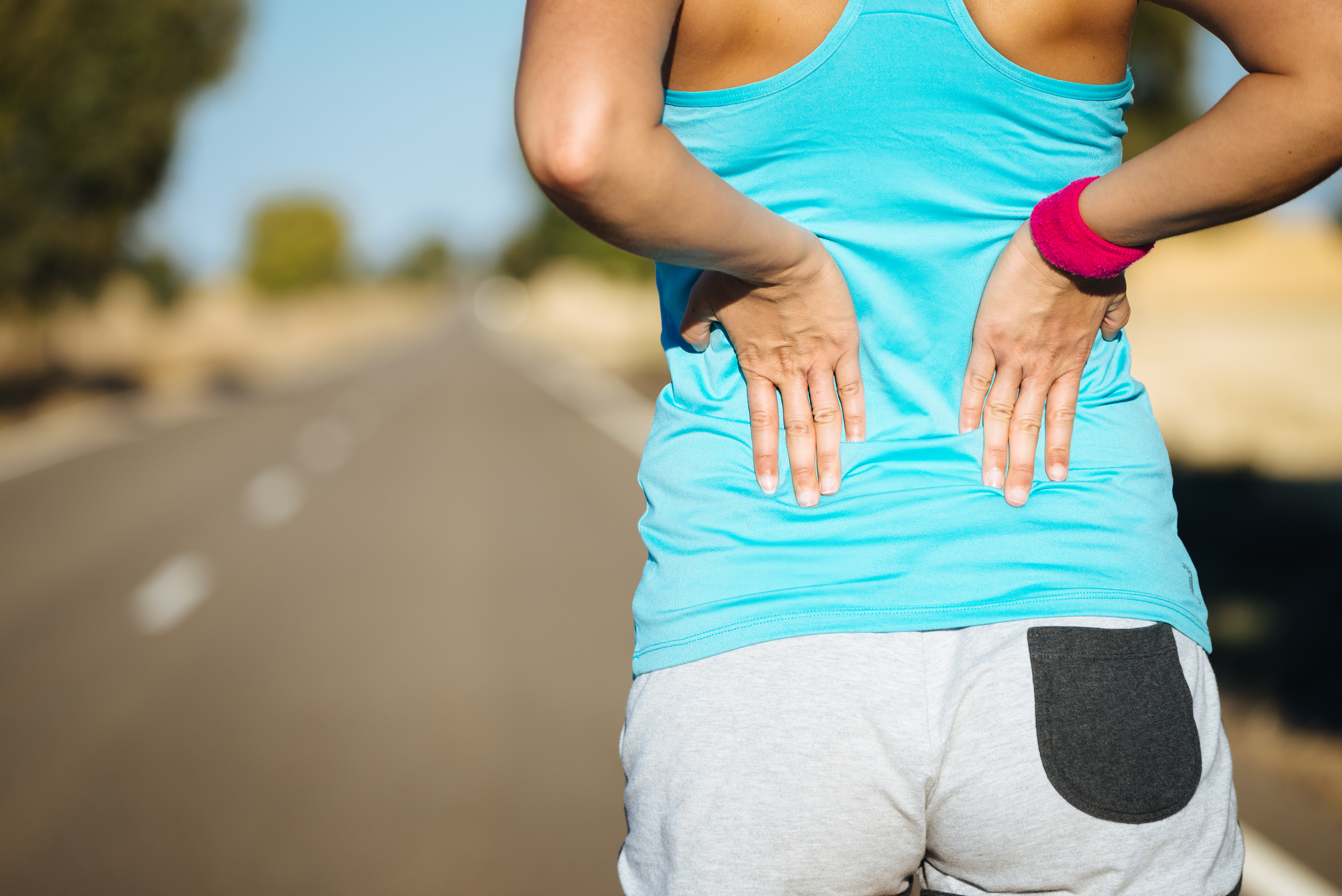 woman lower back pain BodyViva ways to speed up recovery outside the clinic