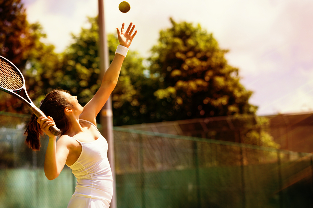 woman tennis serve BodyViva Local Sporting Teams To Keep You Fit & Healthy in Springwood