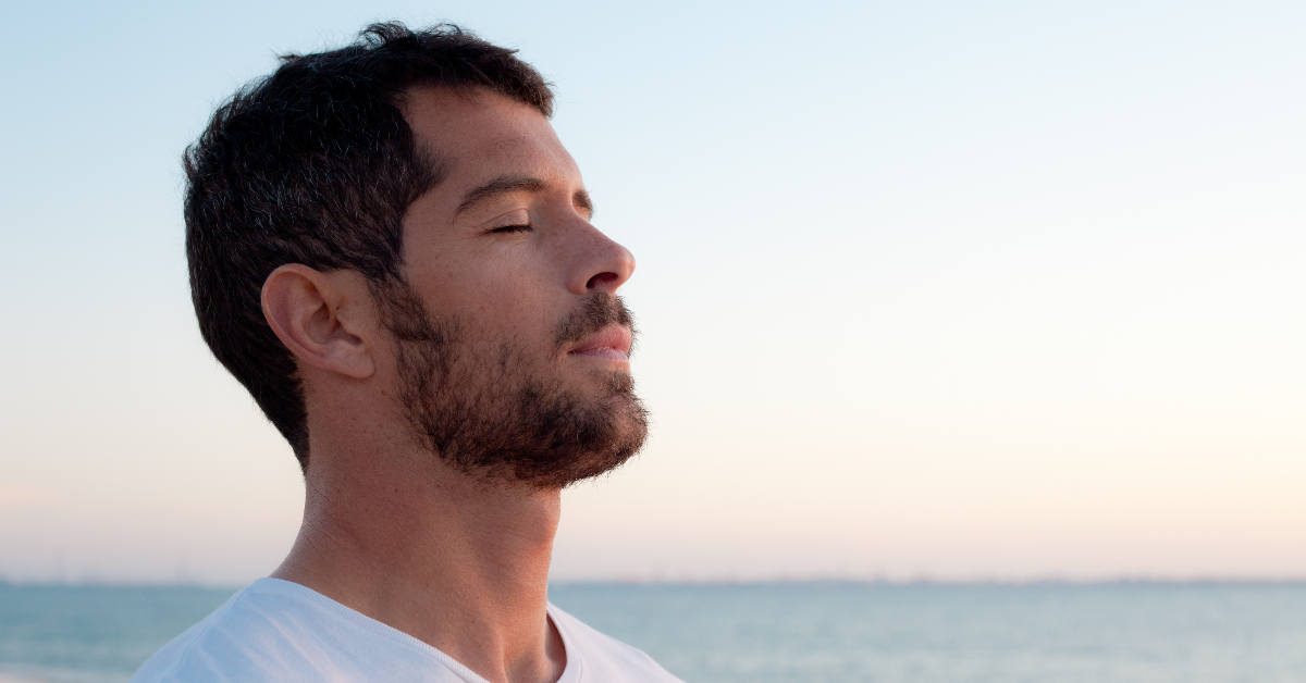 Man Taking Deep Breath deep breathing to relieve body aches