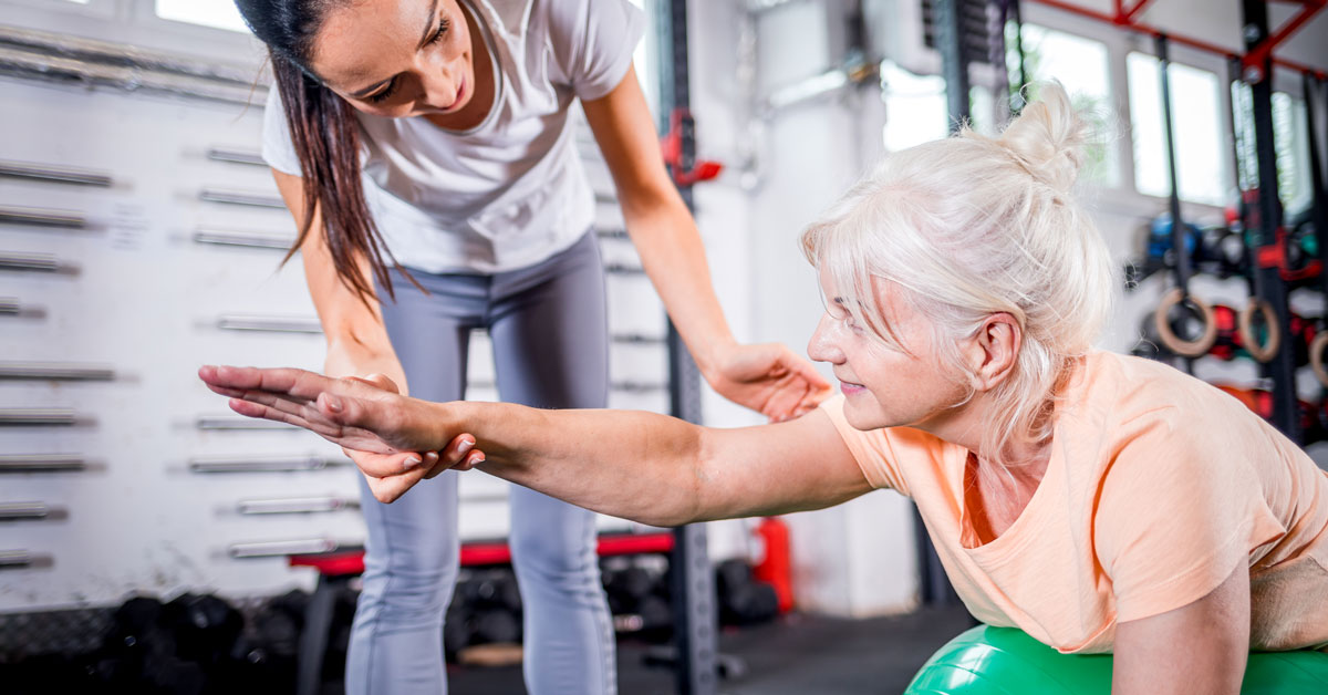 senior woman doing physiotherapy exercise class, bodyviva, strength training, knee pain