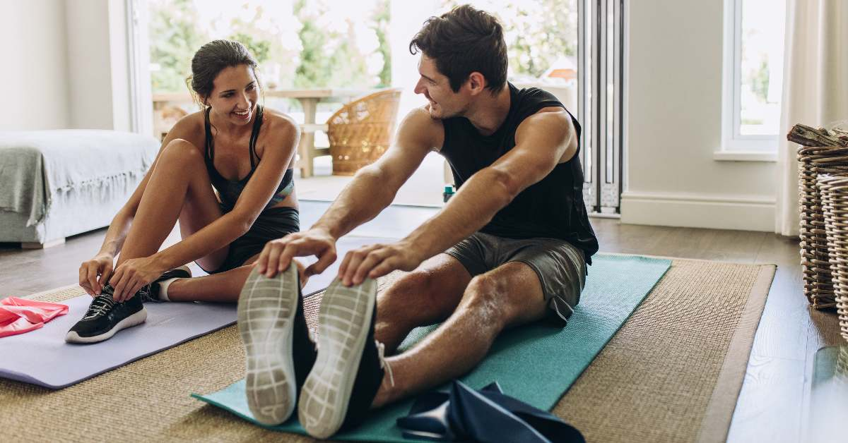 """alt=""""Couple doing a home workout together"""""""